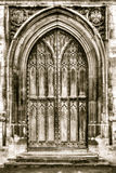 Old arched door in sepia tone Stock Photography