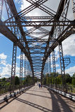 Old arched metal bridge Stock Photography