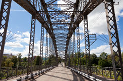Old arched metal bridge Royalty Free Stock Photo