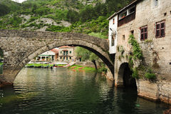 The old arched stone bridge of Rijeka Crnojevica royalty free stock images