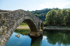 The old arched stone bridge of Rijeka Crnojevica, Montenegro stock photography
