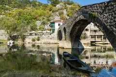 The old arched stone bridge of Rijeka Crnojevica, Montenegro Royalty Free Stock Images