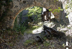Old Arched wall of derelict Olive Mill/Press with millstone presses and workings Royalty Free Stock Photography