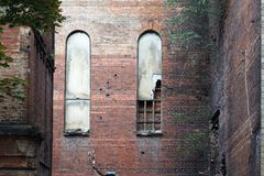 Old arched windows in a brick wall of an old destroyed building, background or concept.  royalty free stock image