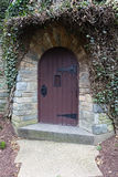 Old arched wooden door Franciscan Monastery Stock Photo