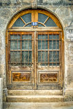Old arched wooden doorway. Royalty Free Stock Image