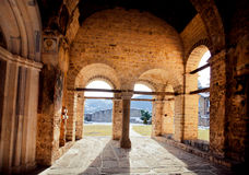 Old arches of monastery. NOVI PAZAR, SERBIA: Old arches of 13th century Sopocani monastery under sun. The Stari Ras complex with monastery was designated a Stock Photo