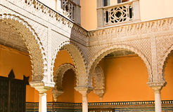 The old arches. SEVILLE, SPAIN - MAY 3, 2012: The  Arabic-style arches made from carved marble decorate the courtyard of Lebrija Palace, on May 3 in Seville Stock Photos