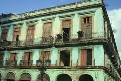 Old architectural green building in Havana, Cuba Stock Photos