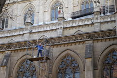 Old Architectural Renovation. Men cleaning a beautiful old building royalty free stock photo