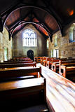 Old architecture church with wooden floor and benches Stock Photography