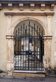 Old architecture of the city with metal gates Stock Image