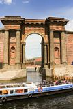 Boat with tourists near the arch. Old architecture of a city place for rest New Holland Royalty Free Stock Images
