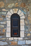 Old architecture detail. Mediterranean architecture detail with an old window and stone wall Royalty Free Stock Images