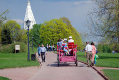 Old architecture of Kolomenskoye park. People walk in park Stock Photography