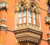 old architecture in london england windows and brick exterior wa Royalty Free Stock Image