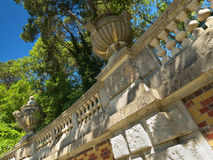 Old architecture in the park. Old wall and architecture elements  in the park Royalty Free Stock Image