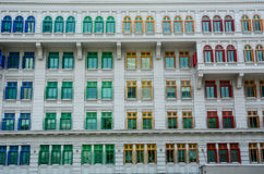 Old architecture in Singapore. Facade of an old building with colorful windows in Singapore. Singapore is global financial center with a tropical climate and Stock Image