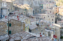 Old architecture in the tuscan village. Houses in the medieval town of Sorano, tuscany, italy Stock Photography
