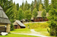 Old architecture of wooden houses in the Museum of the Orava village in Zuberec in Slovakia. Stock Photography