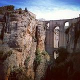 Old architectute in Spain. Old brige in Andalusia royalty free stock image