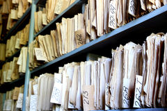 Old archive. Shelves full of files in a messy old-fashioned archive royalty free stock photos