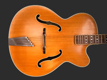 Old archtop jazz guitar body. Old acoustic archtop jazz guitar body, isolated on grey c1959 Stock Photos