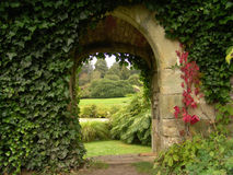Old archway in garden. Old archway with view of gardens stock image