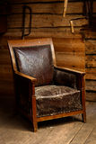 Old armchair in attic Stock Photos