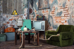 Old armchair, television, radio and table with samovar Stock Image