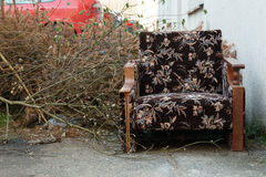 Old armchair trashed outside Stock Images