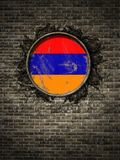 Old Armenia flag in brick wall. 3d rendering of an Armenia flag over a rusty metallic plate embedded on an old brick wall Stock Photo