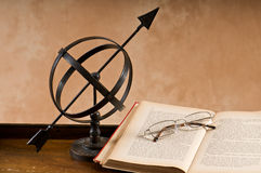 Old Armillary and book. Royalty Free Stock Photography
