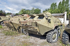 Old armored personnel carrier waiting for repair and modernization. Of the plant royalty free stock images