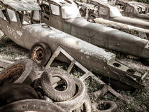 Old army aircraft abandoned in plane graveyard and cemetery Stock Images