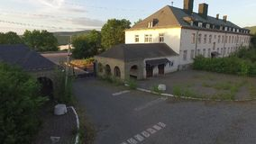 Old army barracks in sundown stock footage