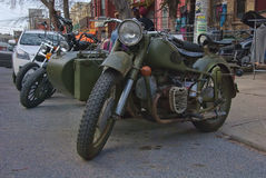 Old army bikes. Here are old army motorcycles, they have kept their army green color. I do not know if they have served in the war, if they are Canadian or Royalty Free Stock Images