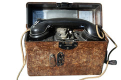 Old army portable phone. A brown old  army portable phone on white background Royalty Free Stock Image