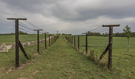 Old army road near Cizov village with roadblock and wires Stock Photo