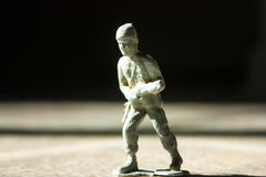 Old Army Soldier Toy. Found this old army soldier toy in the yard, and took some photos, then my dog ate it.  The green soldier is in the center of  the photos Stock Photos