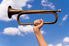 Old army trumpet in hand Royalty Free Stock Photo