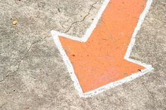 Old arrow sign on the floor Stock Photography