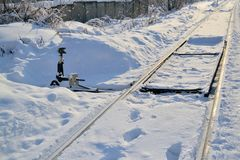 Old arrow train and railway tracks in the winter under the snow royalty free stock photo