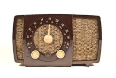 Old art deco Radio. Old art deco table top radio. Brown case with cloth covered front speaker Stock Images