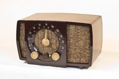 Old art deco Radio. Art deco table top radio.  Brown case with cloth covered front speaker Stock Photography