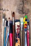 Old art paintbrush set on wooden background Royalty Free Stock Image