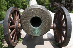 Old artillery cannon with wheels. Front view of an old model cannon. It is made to resemble the cannons from Petru Cercel era, the ruler of Valachia in the XVI stock photography