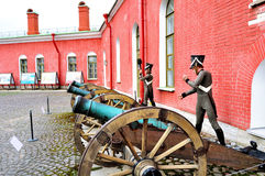 Old artillery guns near the Naryshkin bastion of Peter and Paul fortress with wax statues of Russian soldiers, St Petersburg, Russ Royalty Free Stock Image