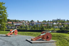 Old artillery guns Trondheim Norway. Old artillery guns overlooking Nidelv river in Trondheim, Norway. In the background residential housing and Norwegian Stock Images