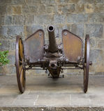 Old artillery iron cannon. Old artillery iron cannon over wheel Royalty Free Stock Photography